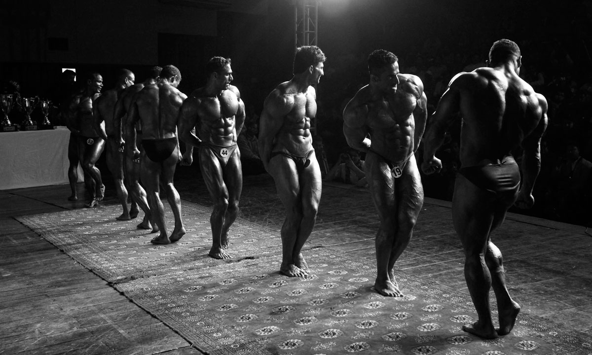 Competitors take part in the 10th South Asian bodybuilding championship. – Photo by Reuters
