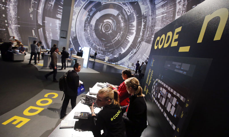 """Visitors look at the """"code_n - code of the new"""" booth, a platform for 50 international start-ups at the CeBIT trade fair in Hanover, March 10, 2014. — Reuters Photo"""