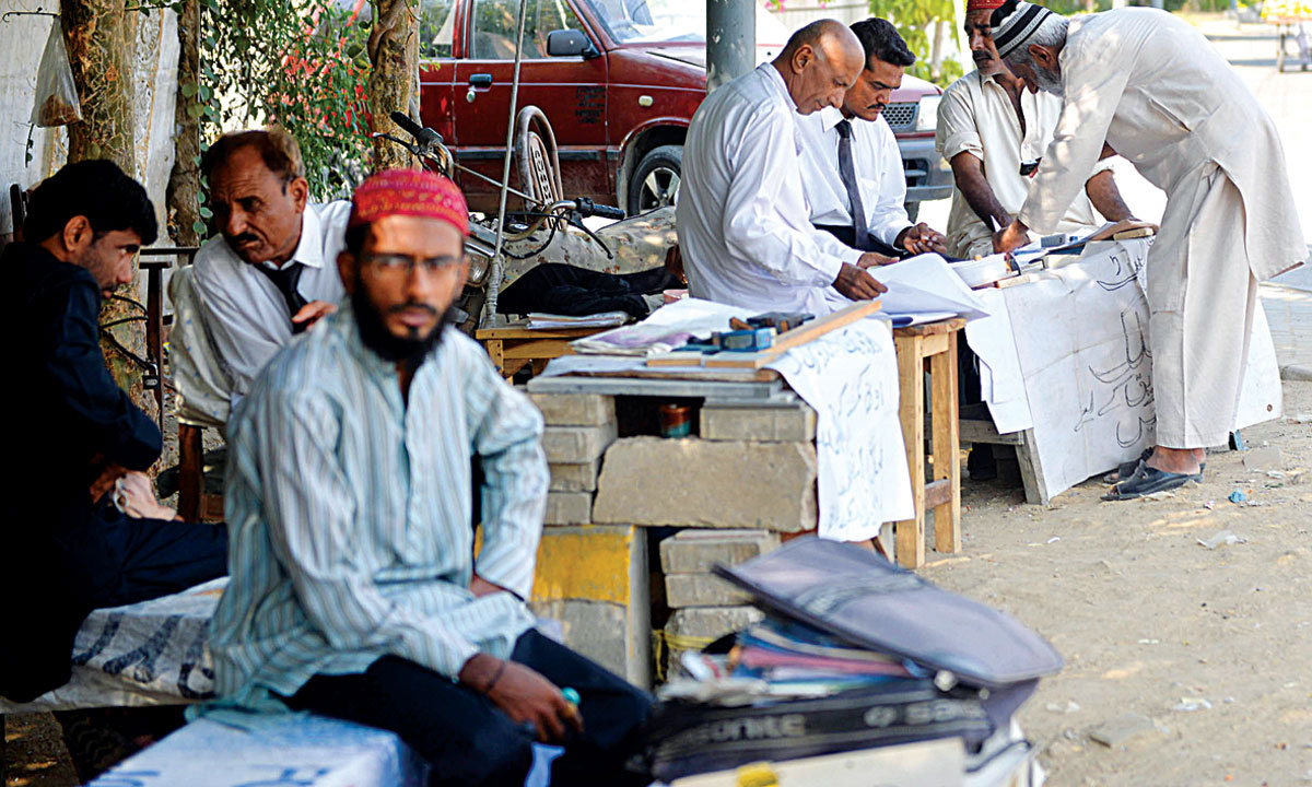 No red tape, no patwari; instant attestations on the roadside. - Photo by White Star
