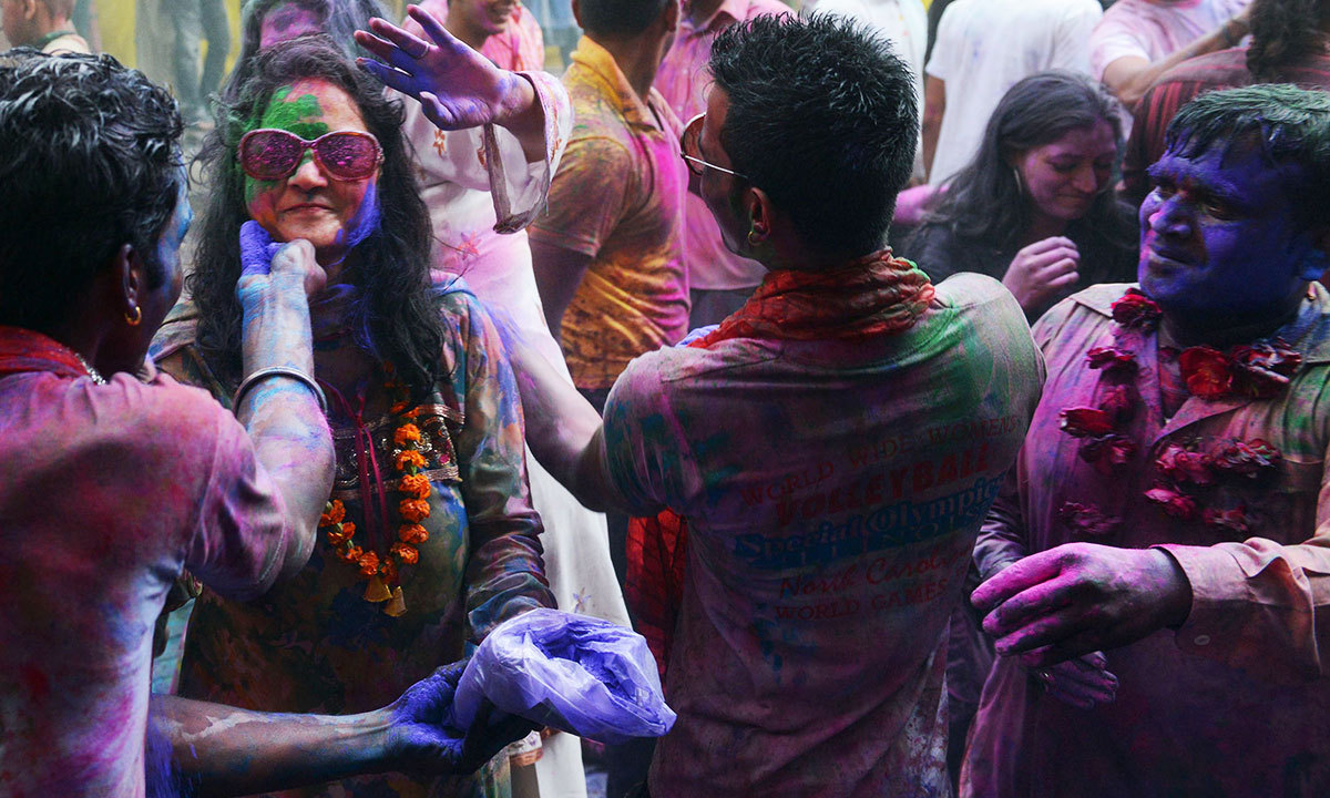Pakistani Hindus paint each other's faces with coloured powder as they take part in celebrations for the Holi festival in Lahore, March 16, 2014.  — Photo by AFP