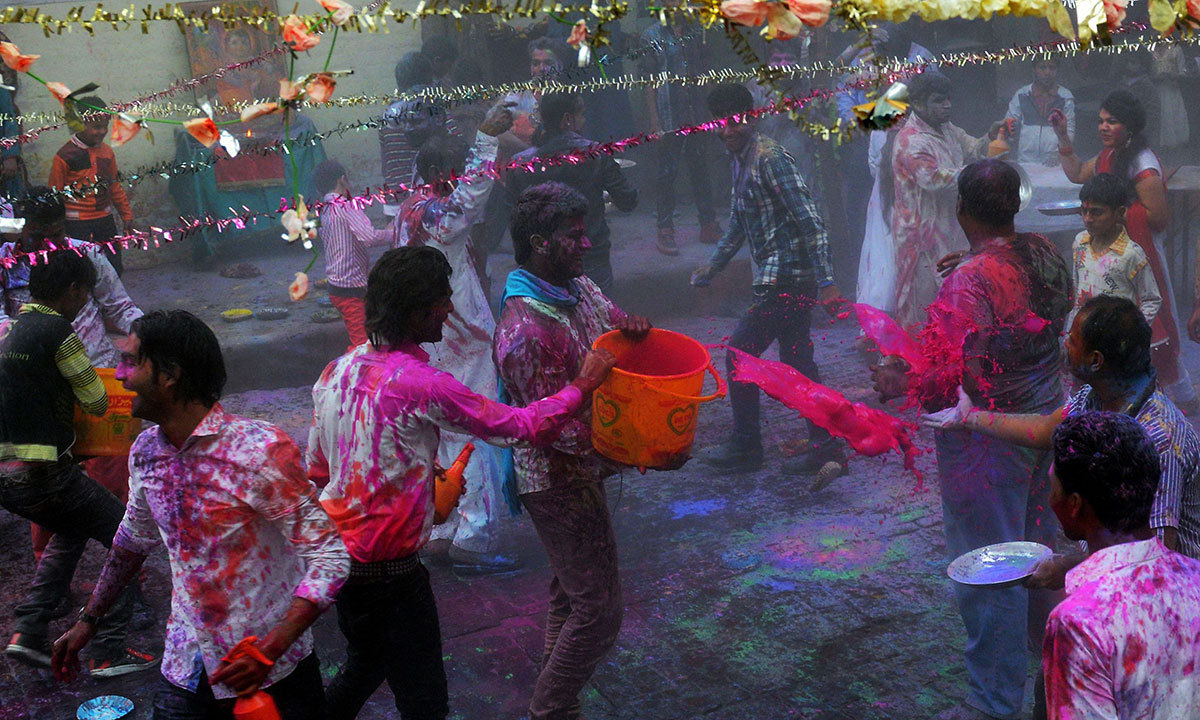 Pakistani Hindus throw coloured water and powder as they take part in celebrations for the Holi festival in Lahore, March 16, 2014. — Photo by AFP