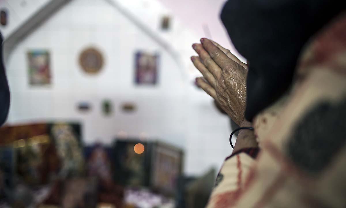 Hindu women pray during the festival of Holi. — Photo by Sara Farid