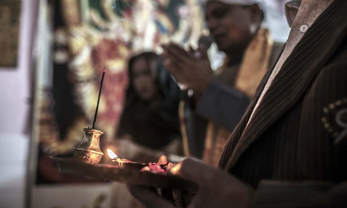 Prayer led by Pundit Channa Lal at Balmiki Temple in Rawalpindi.    — Photo by Sara Farid