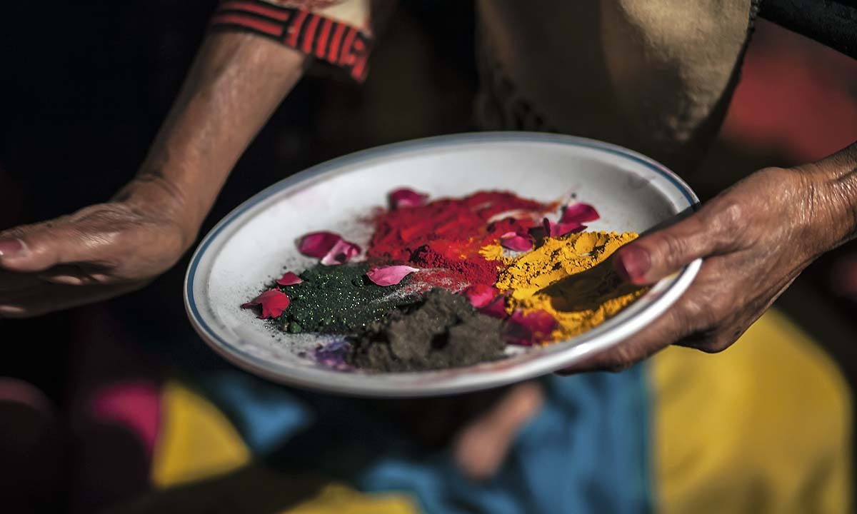 A plate filled with colored powder to paint each other in bright colors of Holi Festival.   — Photo by Sara Farid