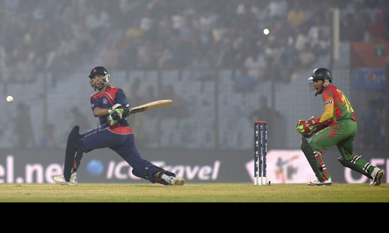 Chittagong: Nepal captain Paras Khadka plays a shot as Bangladesh captain Mushfiqur Rahim looks on during their ICC World Twenty20 match on Tuesday.—AP