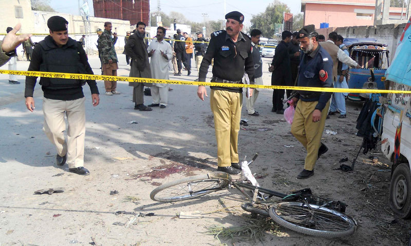 Security officials examine the site of a bomb blast in Kohat, Feb 23, 2014. — Photo by Reuters/File