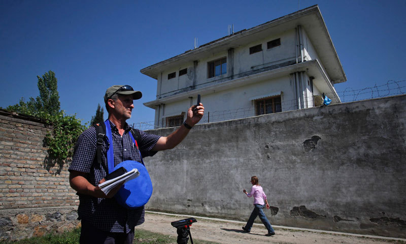 Photo shows journalists outside the compound in Abbottabad where Al Qaeda leader Osama bin Laden was killed. Authorities later razed the compound to the ground.—Photo by Reuters