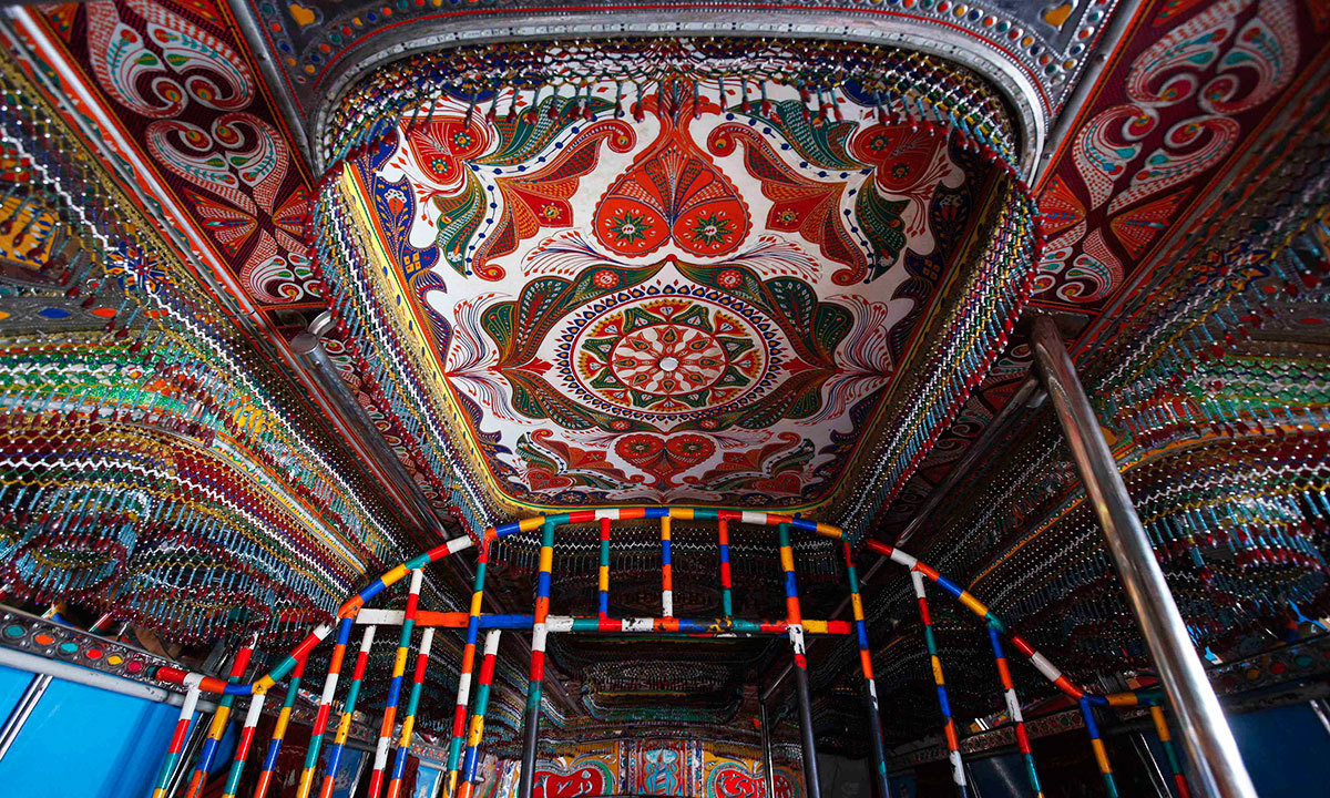The interior roof of a decorated bus parked along a street near to the terminus is seen in Karachi, March 20, 2014.