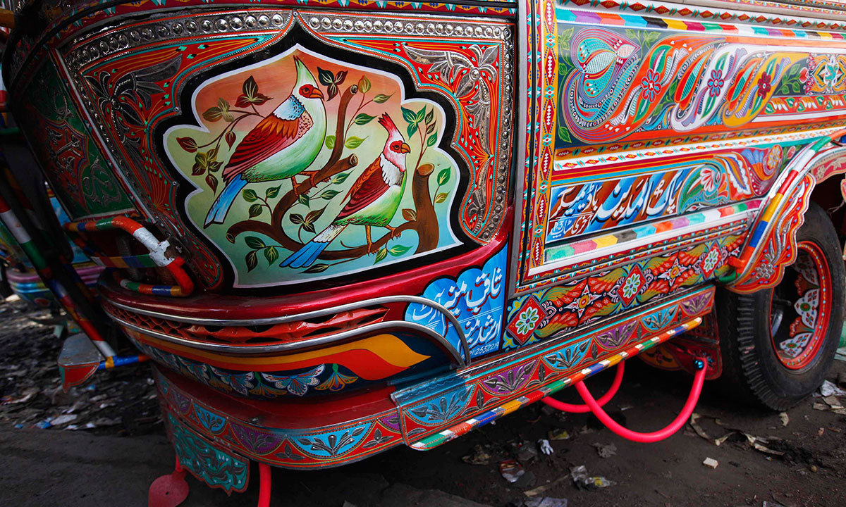 The side view of a decorated bus parked along a street near to the terminus is seen in Karachi, March 19, 2014.