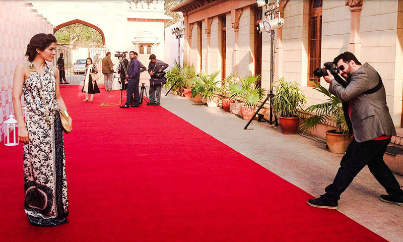 Celebrity photographer, Kohi Marri, photographing Ayesha Omar on the red carpet. —Photo by Madeeha Syed