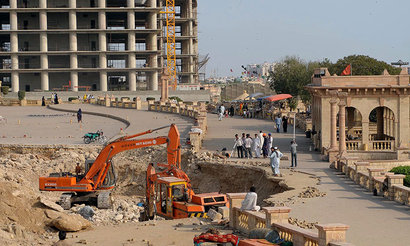 Pakistani labourers work at a construction site of an underpass near a Hindu temple in Karachi on March 24, 2014. – AFP Photo