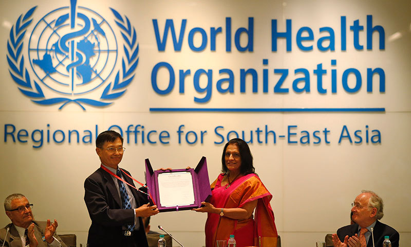 Chairperson of South-East Asia Regional Certification Commission for Polio Eradication Supamit Chunsuttiwat, second left, displays the certificate in New Delhi on Thursday. – AP Photo