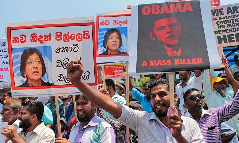 In this March 26, 2014 file photo Sri Lankan government supporters shout slogans against the US and UN during a demonstration in Colombo, Sri Lanka. -AP Photo