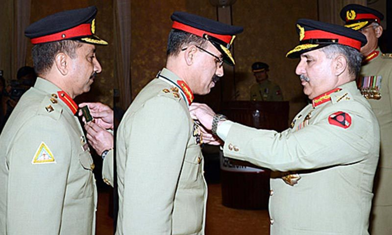 On behalf of the President of Pakistan, General Rashad Mahmood, Chairman Joint Chiefs of Staff Committee, conferred civil awards on eminent scientists and engineers working in the Pakistan Atomic Energy. — Photo by APP