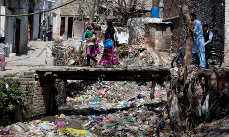 But inside the slum, as outside in this unequal city of Islamabad, people soldier on. — File photo