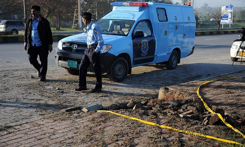 Policemen inspect the site of a bomb explosion in Islamabad. —Photo by AFP