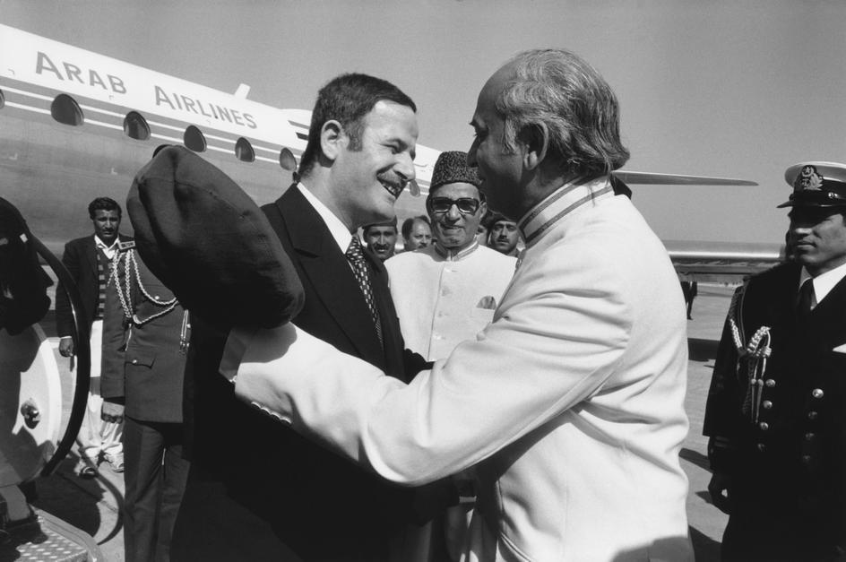 Bhutto greets Syrian leader Hafizul Asad at Lahore airport during the Islamic Summit in 1974. Asad was one of the many leaders of the Muslim world who arrived to attend the historic summit.