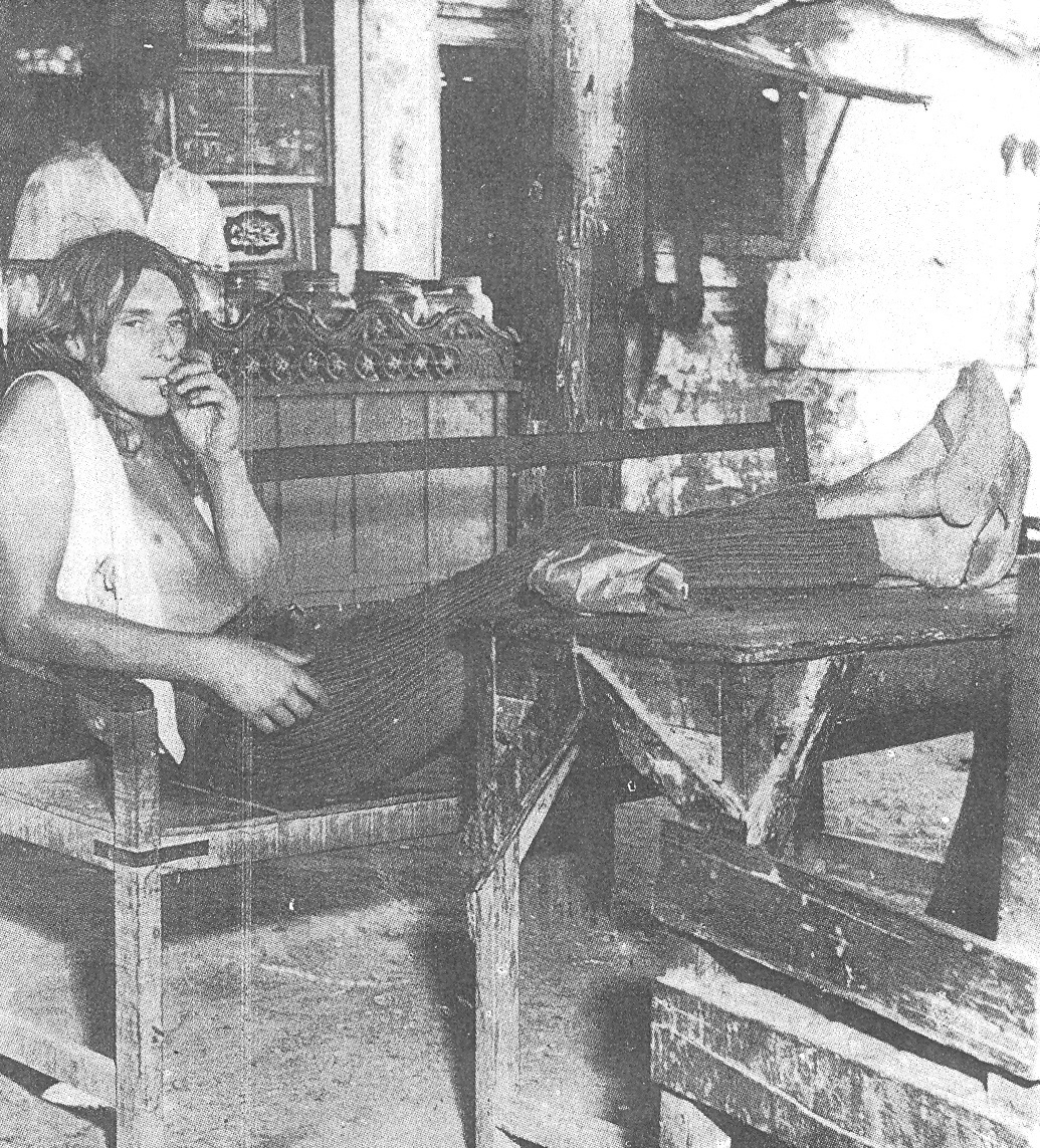 A European tourist relaxing outside a cheap food joint on Burns Road in Karachi (1973).