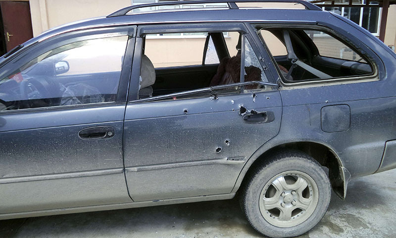 Bullet holes are seen in the car in which Associated Press (AP) photographer Anja Niedringhaus and reporter Kathy Gannon were travelling when they were shot at, in Khost province April 4, 2014. — Photo by Reuters