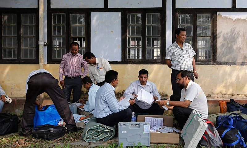Polling officers check the election material after collecting them from a distribution centre ahead of general elections in Jorhat district, in the northeastern Indian state of Assam. —Photo by Reuters
