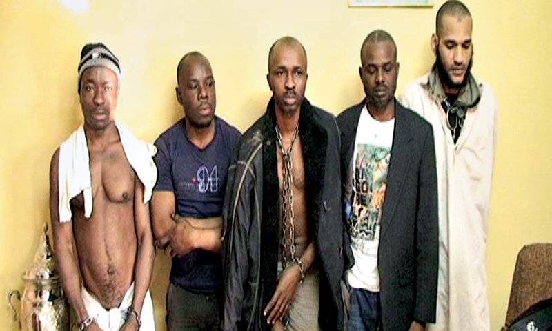 Five former African captives in chains stand in a police station Turbat. —File Photo