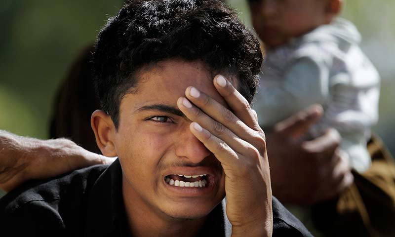 A boy mourns over the death of his family member, a victim of bomb blast, outside a morgue in a local hospital in Islamabad. -AP Photo