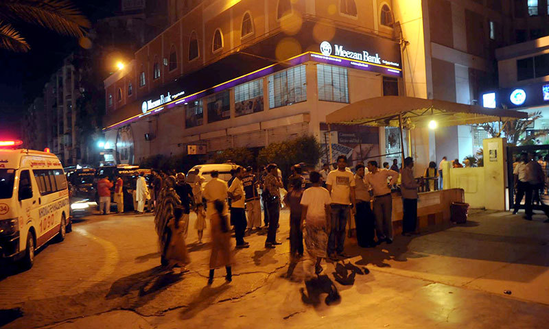 People stand outside Darul Sehat Hospital in Karachi's Gulistan-i-Jauhar area after the incident. – Photo by WhiteStar