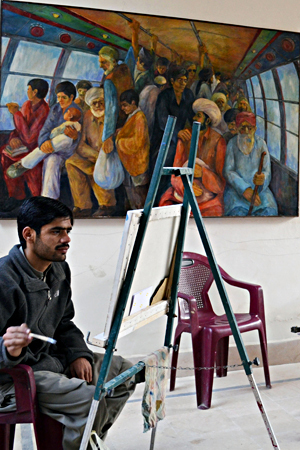 An artist paints at the Shal Art Gallery in Quetta.