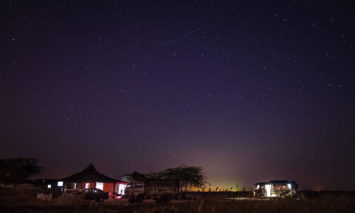 he view of one of Karachi Astronomers Society's camps near Thatta, about 200 km east of Karachi. With a sky clear as this, even faint satellites become as visible as stars - one can be seen making a trail overhead in this long exposure photograph. – Photo by Ramiz Qureshi