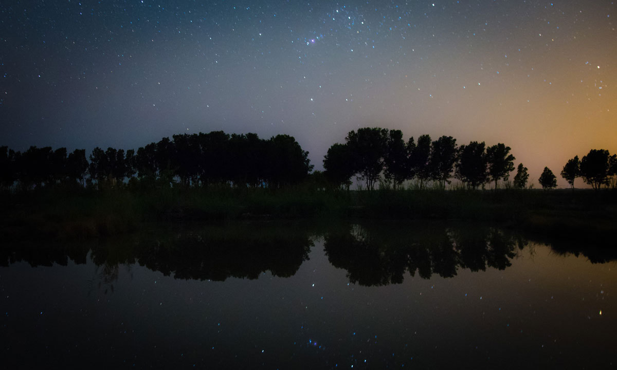 The famous constellation of Orion and it's reflection in the water. – Photo by Ramiz Qureshi