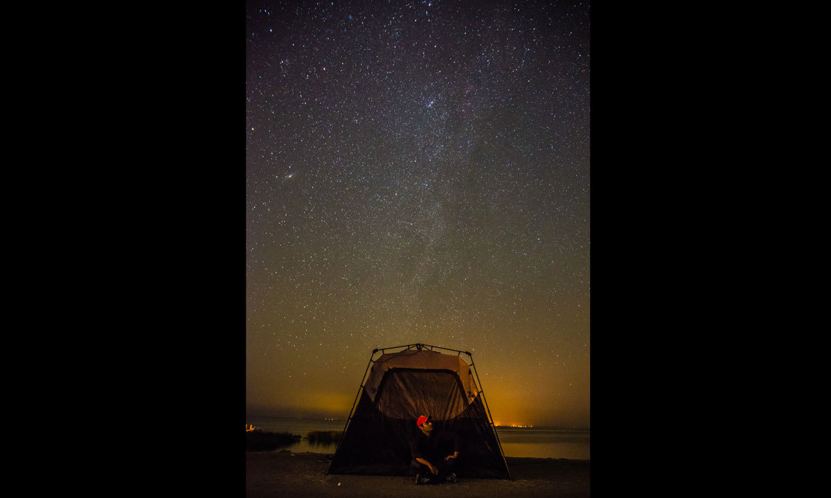 An enthusiast sets up camp beneath the starry sky at Lake Kalri. – Photo by Tausif Muhammad
