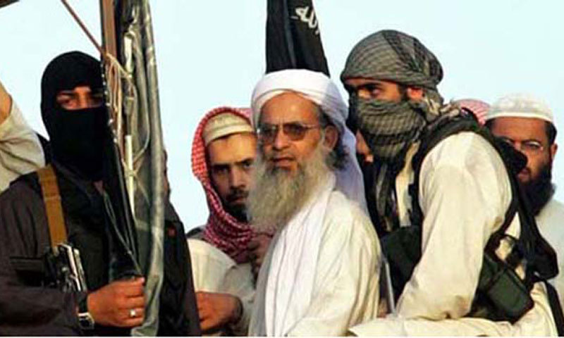 In this picture taken 28 March 2007, shows cleric Abdul Aziz (2-R) surrounded by guards as he stands on a roof of the Lal Masjid during a protest in Islamabad. — File Photo by AFP