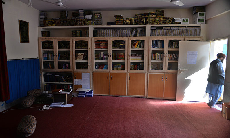A student leaves a library named after slain al Qaeda leader Osama bin Laden at a Jamia Hafsa seminary in Islamabad on April 17, 2014. – AFP Photo