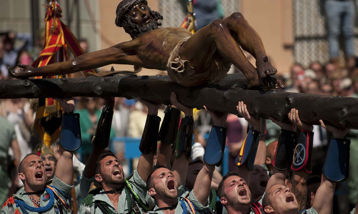 Members of the Spanish Legion carry a statue of the Christ of the Good Death to the Santo Domingo de Guzman church during a Holy Week procession in Malaga, southern Spain, on April 17, 2014. Christian believers around the world mark the Holy Week of Easter in celebration of the crucifixion and resurrection of Jesus Christ. —Photo by AFP.