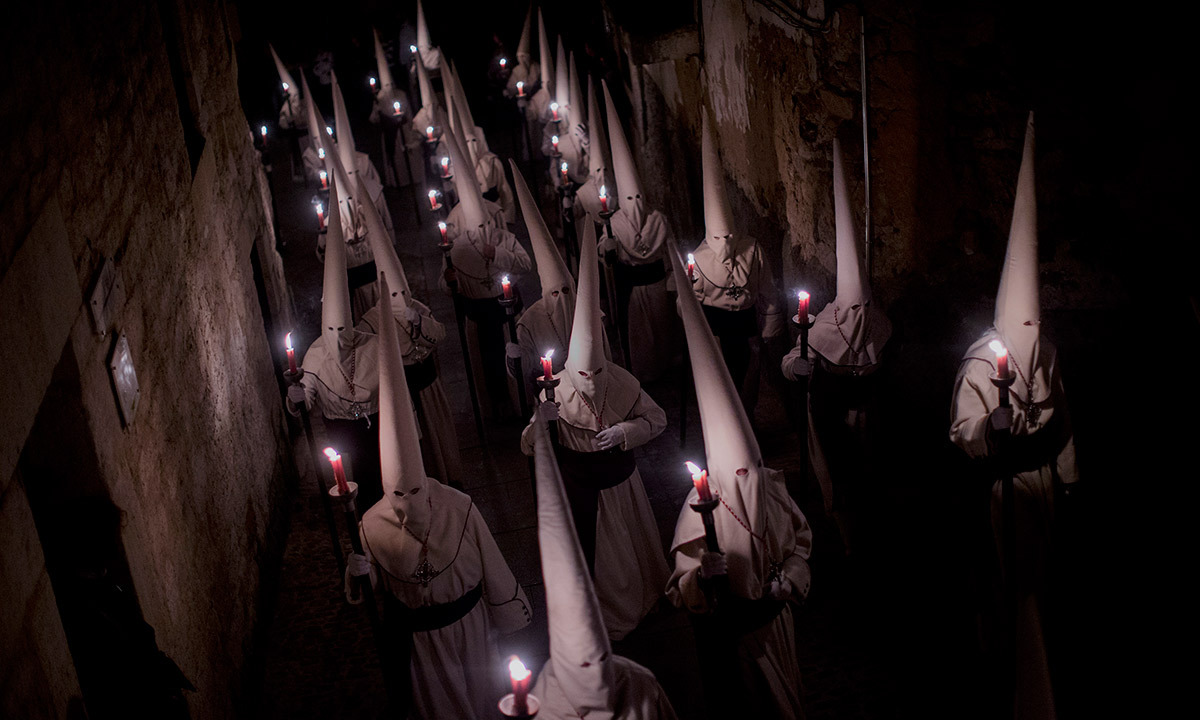Penitents of the Jesus Yacente brotherhood take part in a Holy Week procession in Zamora, northern Spain Friday, April 18, 2014. Hundreds of processions take place throughout Spain during the Easter Holy Week. — Photo by AP.