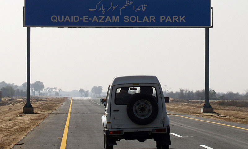 This photograph taken on February 17, 2014 shows a vechile entering the proposed site of the solar energy park at Badaiwani Wala village in Bahawalpur district of Punjab province.  — Photo by AFP
