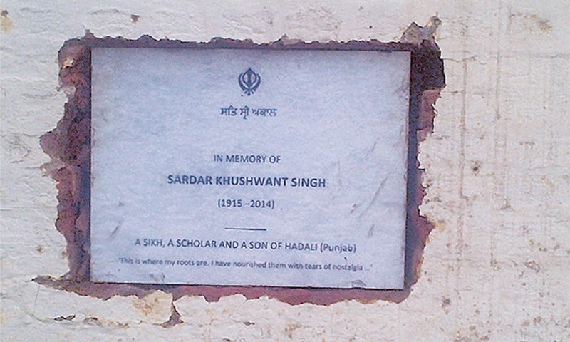The plaque showing the spot where Khushwant Singh's ashes were placed.