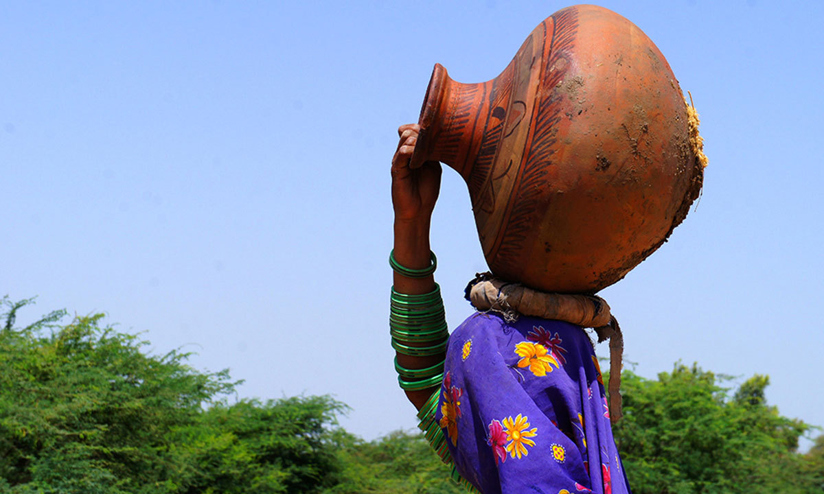 A woman going to get water in Jhuddo, Mirpur Khas District, Sindh. – Photo by Emmanuel Guddu