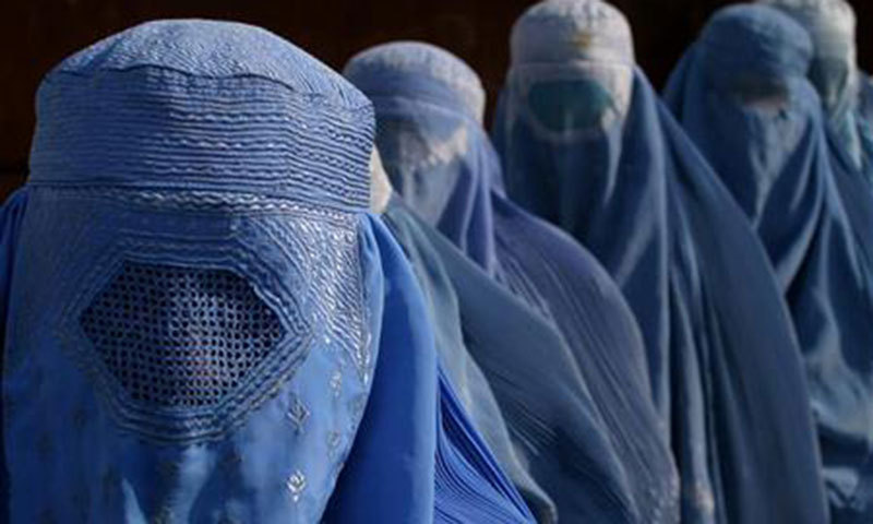 Women wearing the Afghan-influenced burqa, more commonly known as the