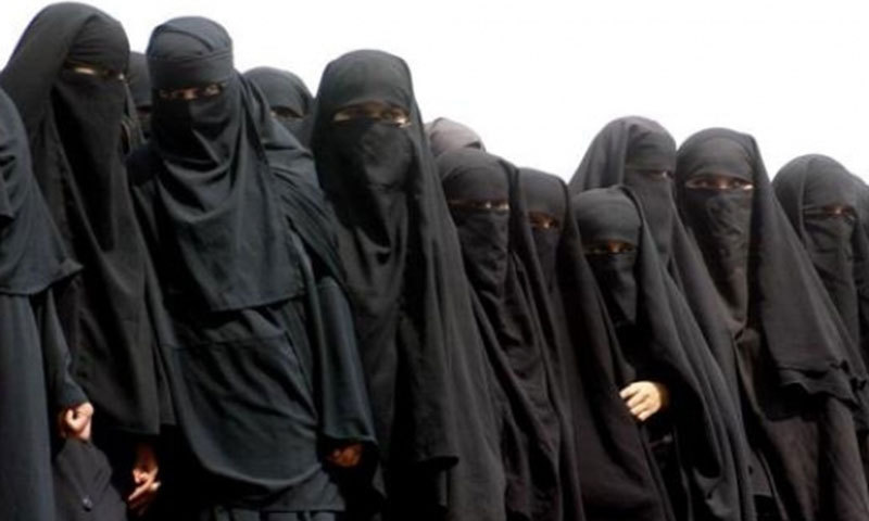 A group of young madressah students wearing the Arab-influenced black burqa. File Photo