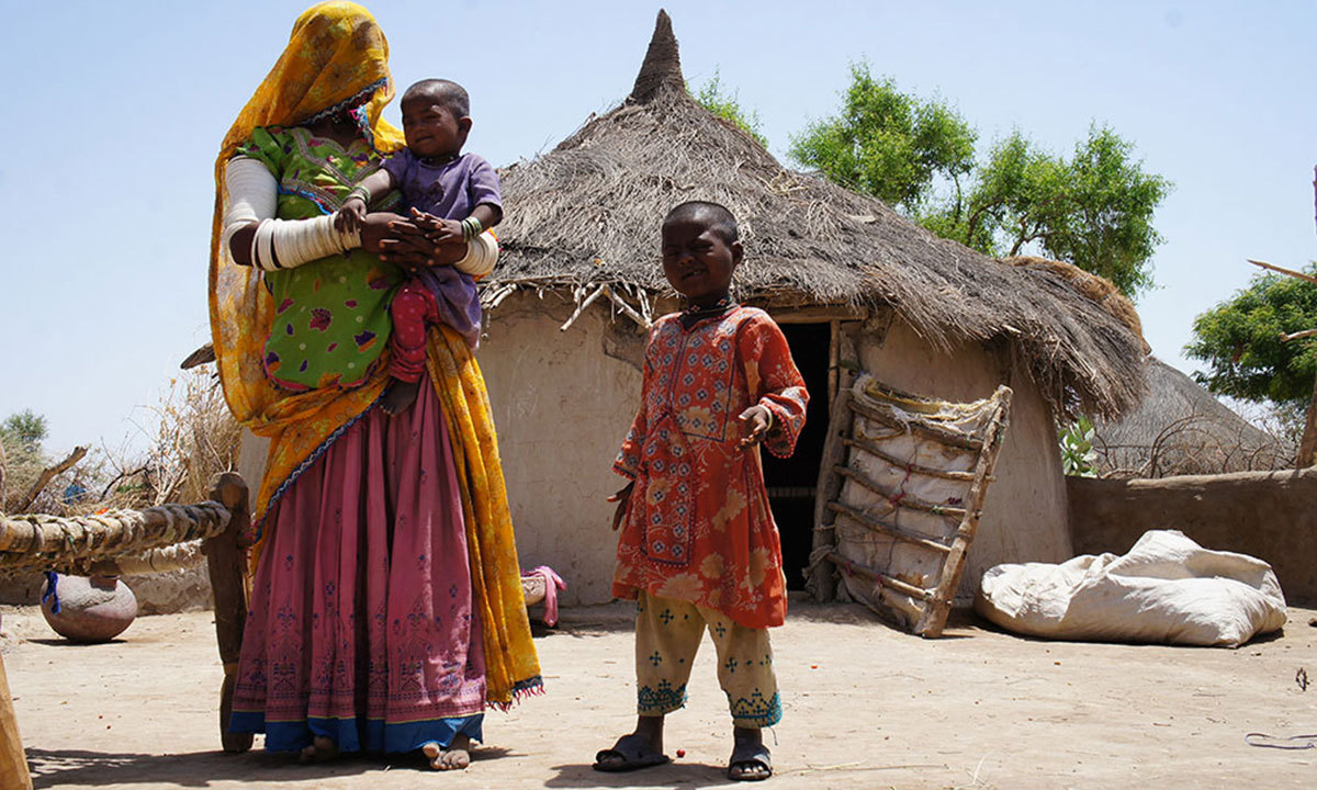 A family in front of their hut in Thar.  – Photo by Emmanuel Guddu