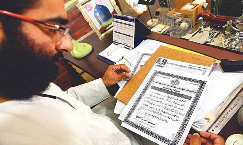 Abdul Malik of the Khanqah-i-Aalia Qadria Bharchundi Sharif in Daharki with Rani Khatoon's conversion certificate.—Fahim Siddiqi/White Star