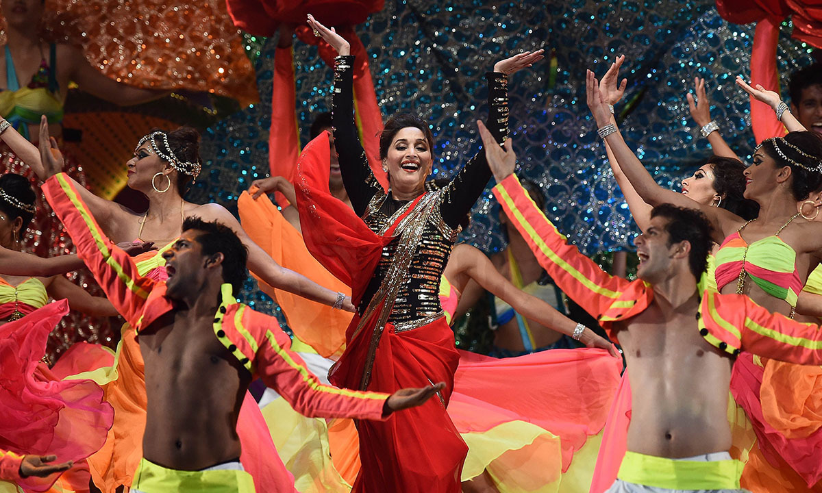 Bollywood actress Madhuri Dixit performs on stage during the fourth and final day of the 15th International Indian Film Academy (IIFA) Awards at the Raymond James Stadium in Tampa, Florida, April 26, 2014. — Photo by AFP
