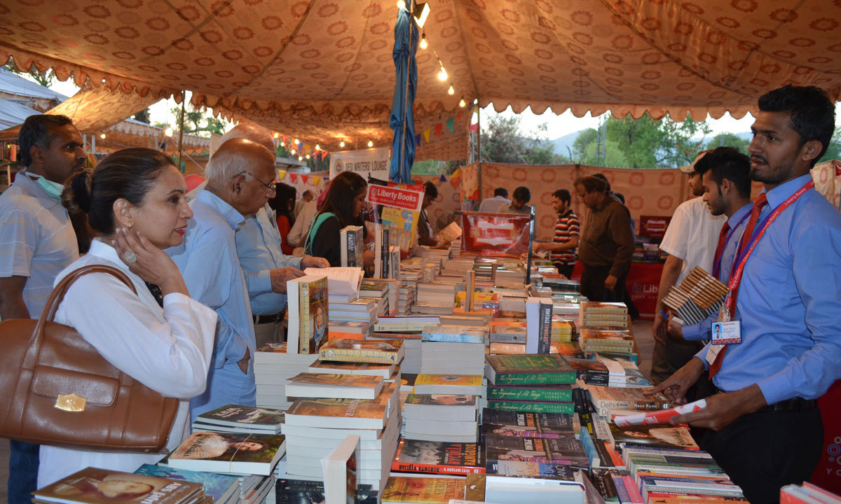 Visitors are seen purchasing books from book stalls at the ILF. – Photo by Irfan Haider