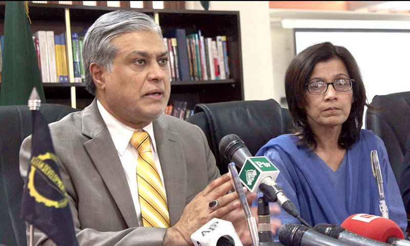 Federal Minister for Finance Senator Ishaq Dar talks to media persons after signing MoU between ADB and Economic Affairs Division in Islamabad on Monday. – APP Photo