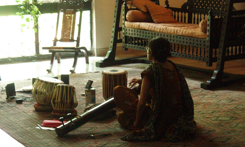 The author playing her tampura.