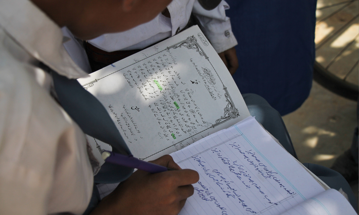 A student completes his homework during lunch break.