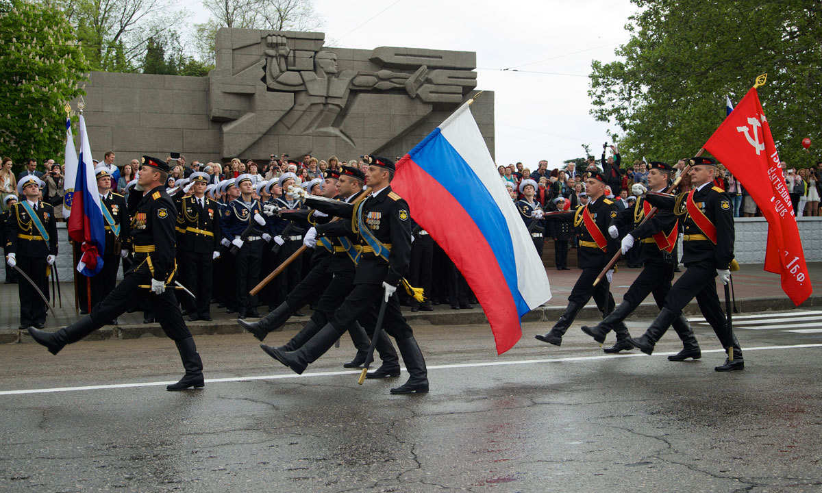 Russian marines carry national flags during a Victory Day military parade, which commemorates the 1945 defeat of Nazi Germany, in Sevastopol, Russia, on Friday, May 9. – Photo by AP