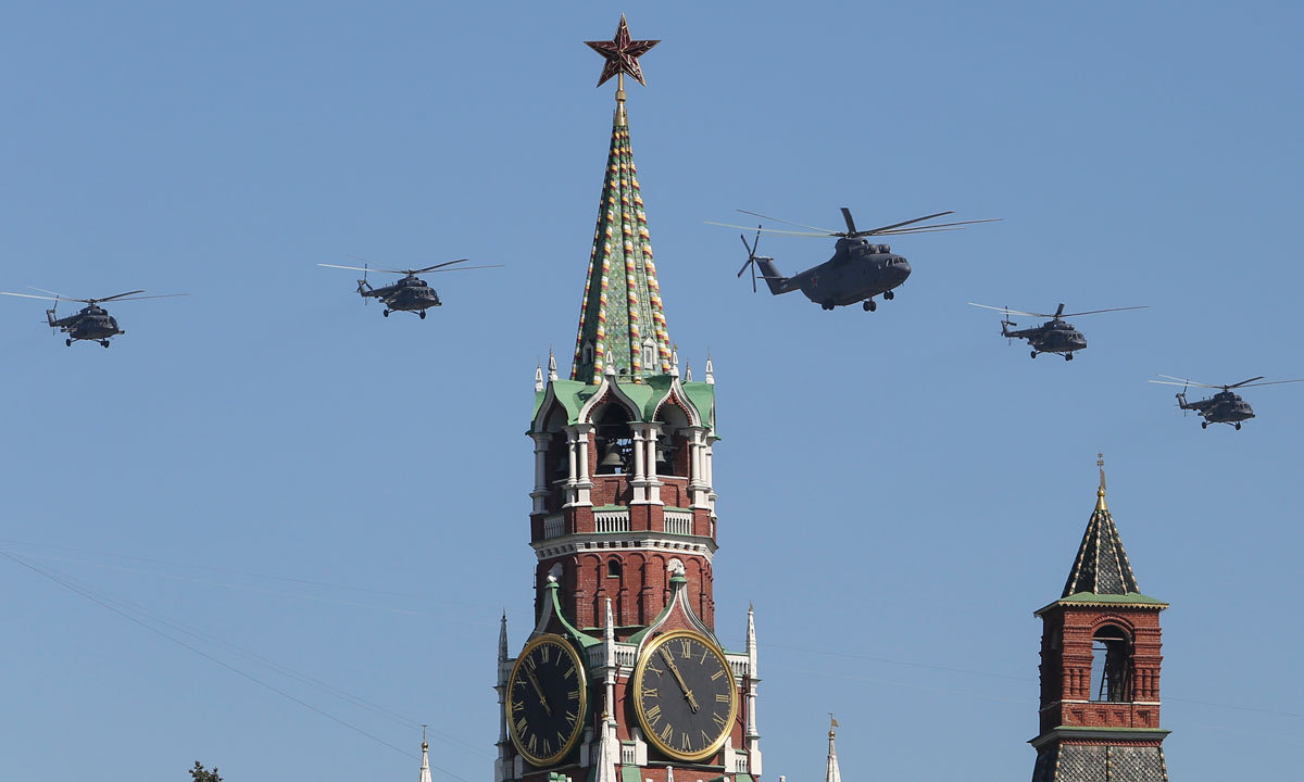 Russian Air Force helicopter Mi-26, center, with Mi-8, flies over Red Square during a Victory Day parade. – Photo by AP