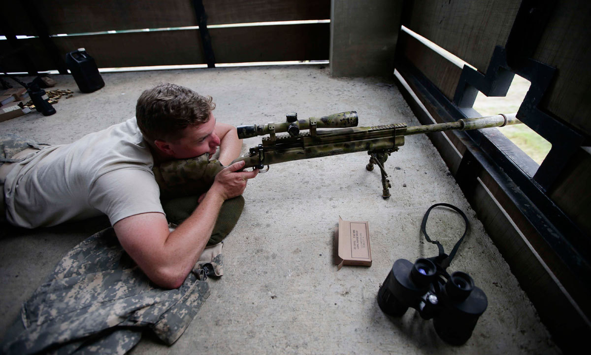 US Army SPC William Walsh of Wis., prepares to fire his sniper's rifle during the live-fire joint US-Philippines military exercise dubbed Balikatan 2014, Saturday, May 10, 2014 at the Philippine Army training camp, Fort Magsaysay, in northern Philippines. – Photo by AP